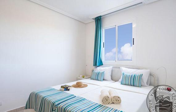 habitacion-cama-arena-beach_3981